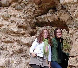 Sara and Mary about to enter through the castle gate... no, a hole in the wall.