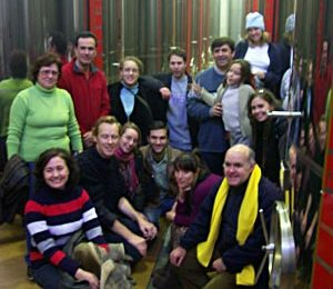 Group shot between the huge vats of oil